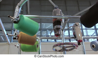 Knitting Weaving Machine in textile industry. Automated...