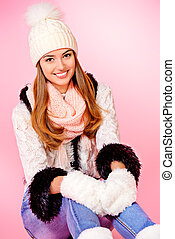 knitwear - Joyful girl in warm knitted clothing smiling at...
