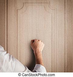 Knock door - Business man knocks to a wooden door