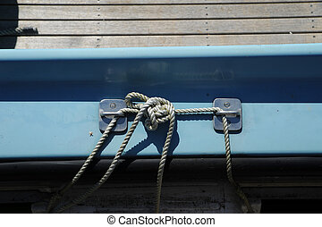 Knot on a blue boat