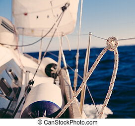 Knot on rope and sailboat crop