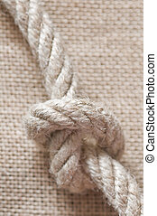 knot on sack background closeup