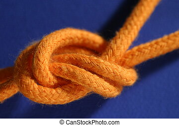 knot - macro of a knot on blue background