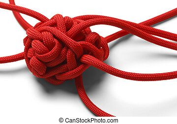 Knot Tangle - Red Rope in A Tangled Mess Isolated on White...