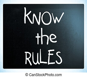 """""""Know the rules"""" handwritten with white chalk on a blackboard"""
