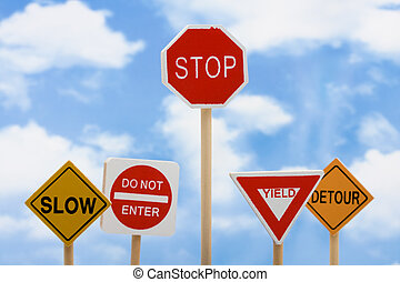 Knowing When to Quit - Road signs sitting on a sky...