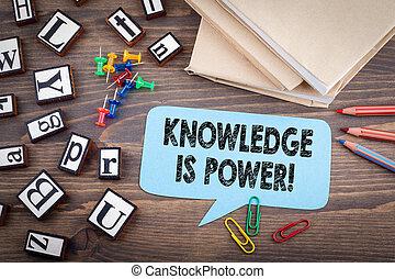 Knowledge is power. Speech Bubble on a dark textured wooden background