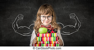 Knowledge is power - Smart kid in class. Happy child against...
