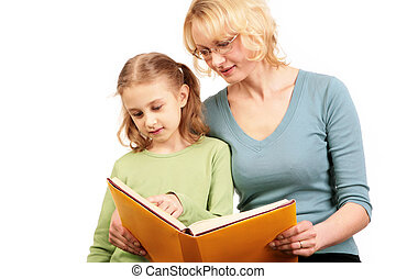 Portrait of loving mother reading book together with his daughter