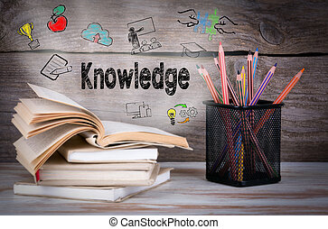Knowledge. Stack of books and pencils on the wooden table.