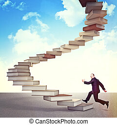 knowledge way - man jump on 3d book stair