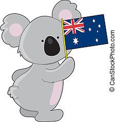 A cute little koala is holding up an Australian flag