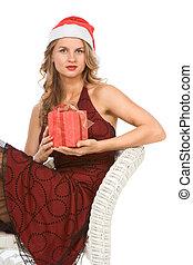 kobieta, blond, santa kapelusz, boże narodzenie obecne