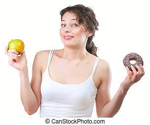 kobieta, diet., wybierając, owoc, młody, między, donut, piękny