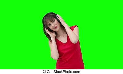 kobieta dzierżawa, słuchawki, znowu, muzykować słuchanie