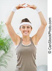 kobieta, gimnastyka, stosowność, zrobienie, uśmiechanie się, ruch
