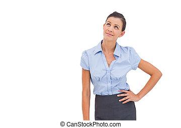 kobieta interesu, myślenie, z, ręka na biodrze