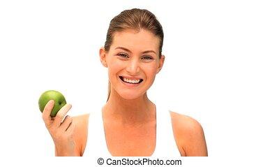 kobieta jedzenie, na, jabłko