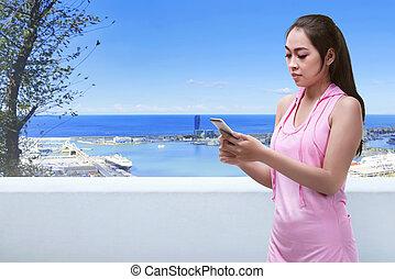 kobieta, jej, biegacz, wpływy, odpoczynek, smartphone, asian, używając