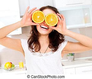 kobieta, oczy, na, pomarańcza, młody, portret, zdrowy, zabawny