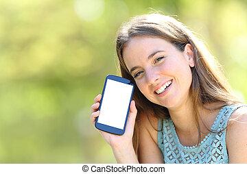 kobieta, pokaz, telefon, zielony, okienko osłaniają, szczęśliwy