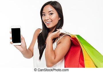 kobieta, ruchomy, pokaz, młody, telefon, asian, czysty, uśmiechanie się, ekran