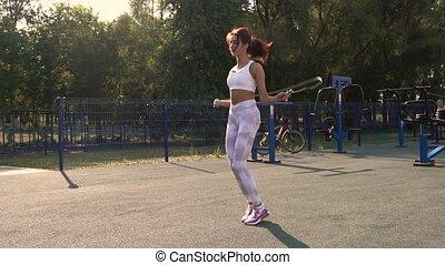 kobieta, sala gimnastyczna, młody, związać, skokowy, outdoors