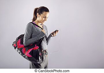 kobieta, sala gimnastyczna torba, muzykować słuchanie, stosowność