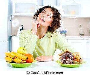 kobieta, wybierając, owoce, młody, concept., dieting, między, słodycze