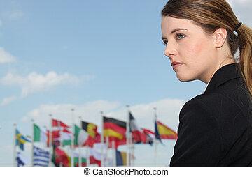 kobieta, z, bandery, w, przedimek określony przed rzeczownikami, tło