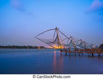 Kochi chinese fishnets in twilight in Kochi, Kerala. Fort Kochin, Kochi, Kerala, India