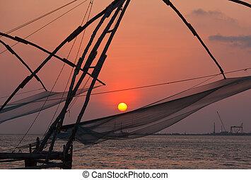 Kochi chinese fishnets on sunset. Fort Kochin, Kochi, Kerala...