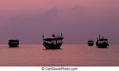 Koh Rong Island, Cambodia at Sunrise. strong vibrant Colors, Boats and Ocean