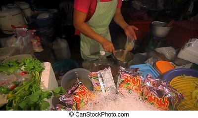 Food Market. Cook prepares the night market noodle soup