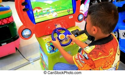 KOH SAMUI, THAILAND 19 JULY 2014 asian boy plays in game room. HD. 1920x1080