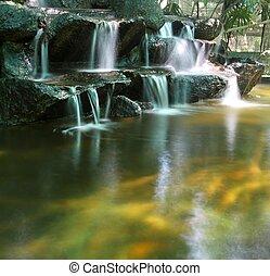 Koi fish pond with waterfalls