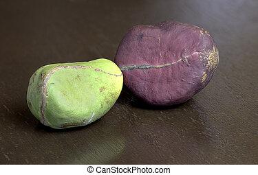 Kola Nuts on Wood Surface