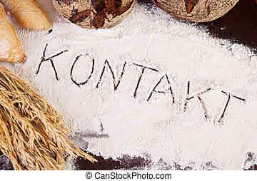 Kontakt, written in flour - The word 'Kontakt', written in...