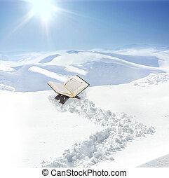 Koran at snow in mountain, concept