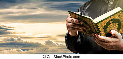 Koran with muslims man . Koran - holy book of Muslims .vintage dark filter