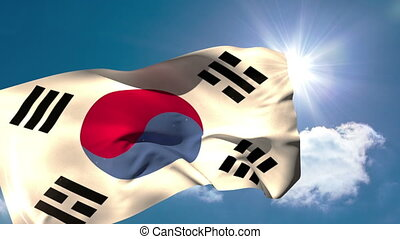Korea republic national flag blowing in the breeze on blue...