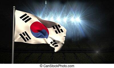Korea republic national flag waving on flagpole on black...