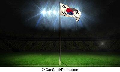 Korea Republic national flag waving on flagpole on football...