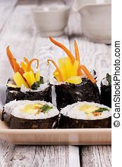 Korean cuisine. - Close up image of Korean sushi displayed...