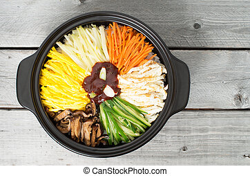 Korean cuisine, vegetarian Bibimbap in a clay pot on a...