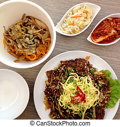 Korean food with side dish - Japchae and korean pasta with...