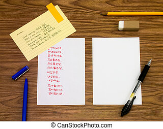 Korean; Learning New Language Writing Words on the Notebook