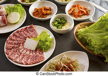 Korean side dishes - A horizontal shot of beef with korean ...