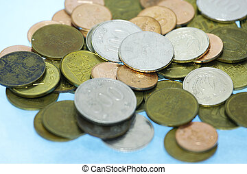 Korean won coins in cyan background with shallow dof