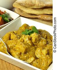 Korma chicken - Closeup of chicken pieces in korma spices